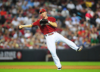 Jun. 29, 2011; Phoenix, AZ, USA; Arizona Diamondbacks shortstop Stephen Drew makes an off balance throw to first base for an out in the fifth inning against the Cleveland Indians at Chase Field. Mandatory Credit: Mark J. Rebilas-