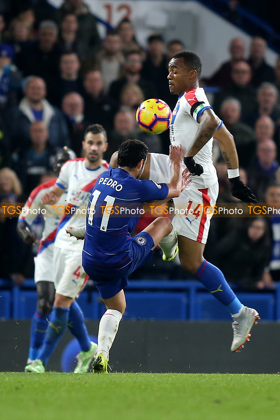 Jordan Ayew of Crystal Palace and Chelsea's Pedro challenge for the ball during Chelsea vs Crystal Palace, Premier League Football at Stamford Bridge on 4th November 2018
