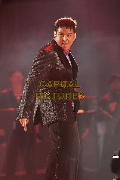 Tariano 'Taj' Adaryll Jackson II.Michael Forever Tribute Concert at The Millenium Stadium, Cardiff, Wales, UK 8th October 2011.performing live in on stage music gig half length black suit side .CAP/MAR.© Martin Harris/Capital Pictures.