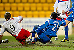 St Johnstone v Inverness Caley Thistle....02.01.11  .Collin Samuel slides in to score the only goal of the game.Picture by Graeme Hart..Copyright Perthshire Picture Agency.Tel: 01738 623350  Mobile: 07990 594431