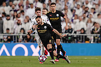 26th February 2020; Estadio Santiago Bernabeu, Madrid, Spain; UEFA Champions League Football, Real Madrid versus Manchester City; Ilkay Gundogan† (Manchester City) challenges for control of the ball with Federico Valverde (Real Madrid)
