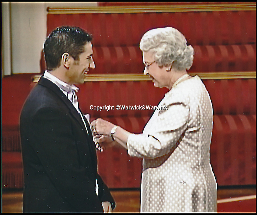 BNPS.co.uk (01202 558833)<br /> Pic: Warwick&Warwick/BNPS<br /> <br /> Robertson receiving his medal from The Queen.<br /> <br /> An Iraq war hero is selling his £100,000 gallantry medal he won for a notorious battle so he can help get his son on the property ladder.<br /> <br /> Sergeant Gordon Robertson has proudly displayed the Conspicuous Gallantry Cross in his home since he was awarded it following the Battle of Majar al Kabir in which six British Royal Military policemen were killed in 2003.<br /> <br /> He has now decided to sell his decoration - one down from the Victoria Cross - because he wants to help buy his grown-up son his first house.
