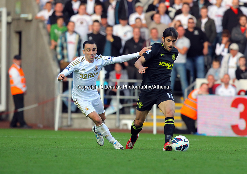 Saturday, 20 October 2012<br /> Pictured L-R: Leon Britton of Swansea against Jordi Gomez of Wigan<br /> Re: Barclays Premier League, Swansea City FC v Wigan Athletic at the Liberty Stadium, south Wales.