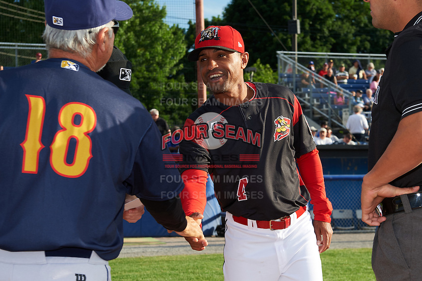 Batavia Muckdogs manager Angel Espada (4) shakes hands with Johnny Rodriguez (18) before a game against the State College Spikes on June 22, 2016 at Dwyer Stadium in Batavia, New York.  State College defeated Batavia 11-1.  (Mike Janes/Four Seam Images)