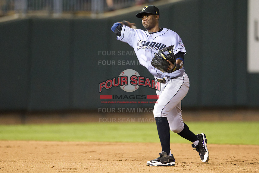 Omaha Storm Chasers shortstop Irving Falu #12 throws to first during the Pacific Coast League baseball game against the Round Rock Express on July 22, 2012 at the Dell Diamond in Round Rock, Texas. The Express defeated the Chasers 8-7 in 11 innings. (Andrew Woolley/Four Seam Images).