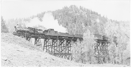 Wide angle fireman side view of RGS #74 crossing bridge 19-A with a 5-car Rocky Mountain Railroad Club special.<br /> RGS  Leopard Creek Canyon, CO  Taken by Maxwell, John W. - 5/28/1949
