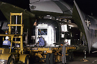 Motorhome carrying Apollo 11 astronauts being unloaded from a USAF C-141 transport at Ellington Air Force Base very early Sunday, 27 July 1969, after a flight from Hawaii.