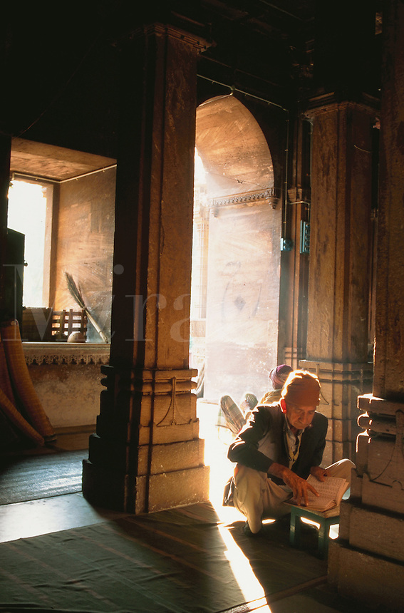 A man prayed within shadow and light in the Rani Ruparvati mosque. Ahmedabad, India.