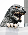 April 12, 2015, Tokyo, Japan - Japan's fire-breathing, building-stomping Godzilla returns to the nation's capital on Sunday, April 12, 2015. The life-size head of the world-renowned fictional monster was unveiled atop a hotel balcony some 52 meters above ground in a new commercial complex in Tokyo's Shinjuku district.  (Photo by Natsuki Sakai/AFLO) AYF -mis-