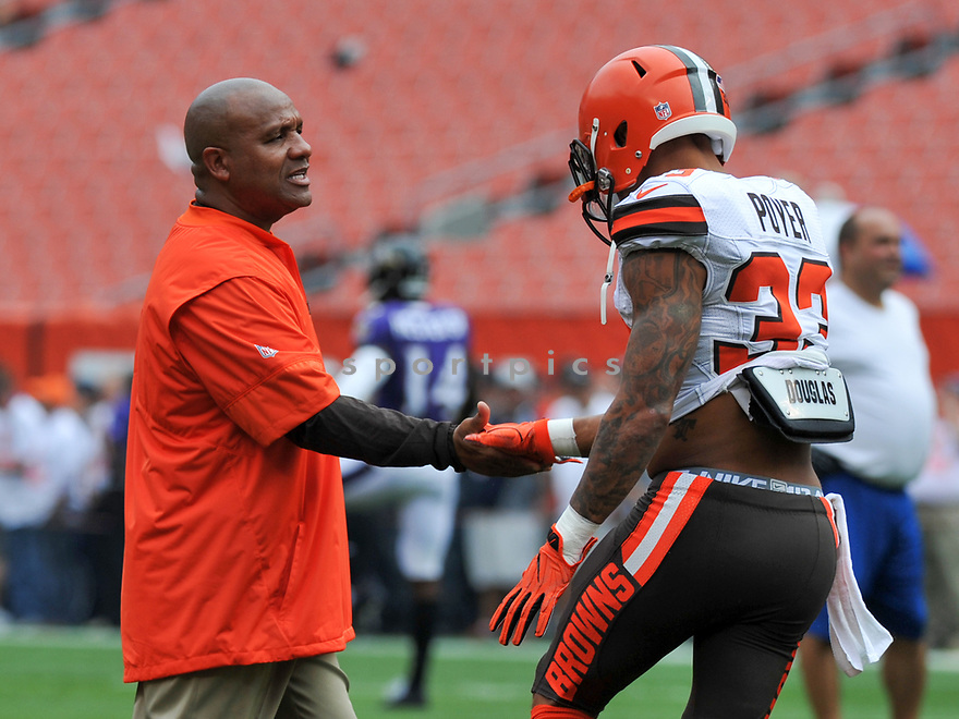 CLEVELAND, OH - JULY 18, 2016: Head coach Hue Jackson of the Cleveland Browns shakes hands with safety Jordan Poyer #33 on the field prior to a game against the Baltimore Ravens on July 18, 2016 at FirstEnergy Stadium in Cleveland, Ohio. Baltimore won 25-20. (Photo by: 2017 Nick Cammett/Diamond Images)  *** Local Caption *** Hue Jackson(SPORTPICS)