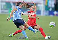 Portland, Oregon - Saturday July 2, 2016: Erin Simon kicks the ball in front of Portland Thorns FC forward Nadia Nadim (9) during a regular season National Women's Soccer League (NWSL) match at Providence Park.
