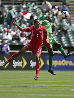 Blas Perez (7) goes up for the header against Eddie Viator (5). Guadeloupe defeated Panama 2-1 during the First Round of the 2009 CONCACAF Gold Cup at Oakland Coliseum in Oakland, California on July 4, 2009.