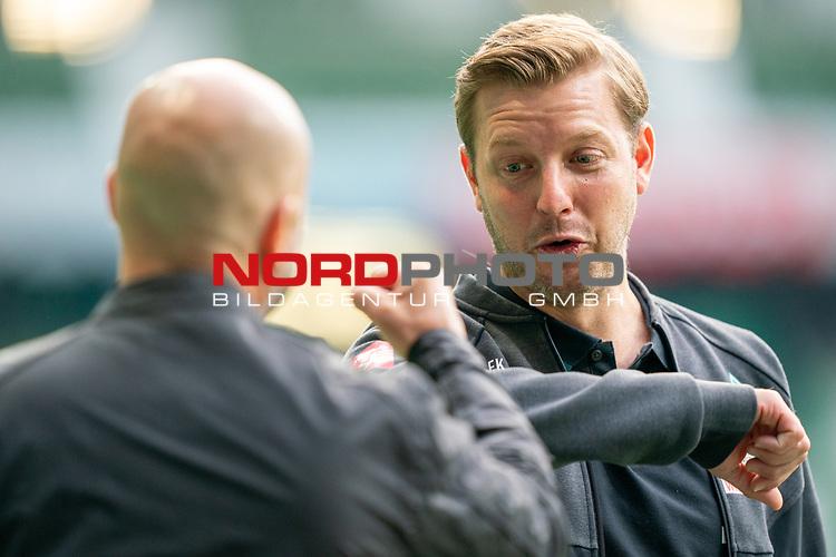 Begruessung Florian Kohfeldt (Trainer SV Werder Bremen) re und Peter Bosz Trainer / Headcoach (Bayer 04 Leverkusen),<br /> <br /> Sport: Fussball: 1. Bundesliga: Saison 19/20: <br /> 26. Spieltag: SV Werder Bremen vs Bayer 04 Leverkusen, 18.05.2020<br /> <br /> Foto ©  gumzmedia / Nordphoto / Andreas Gumz / POOL <br /> <br /> Nur für journalistische Zwecke! Only for editorial use!<br />  DFL regulations prohibit any use of photographs as image sequences and/or quasi-video.