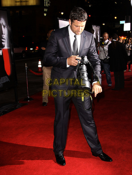GERARD BUTLER.The Overature Film L.A. Premiere of Law Abiding Citizen held at The Grauman's Chinese Theater in Hollywood, California, USA. .October 6th, 2009 .full length grey gray suit black camera lens taking picture photograph looking down .CAP/ADM/KB.©Kevan Brooks/AdMedia/Capital Pictures.