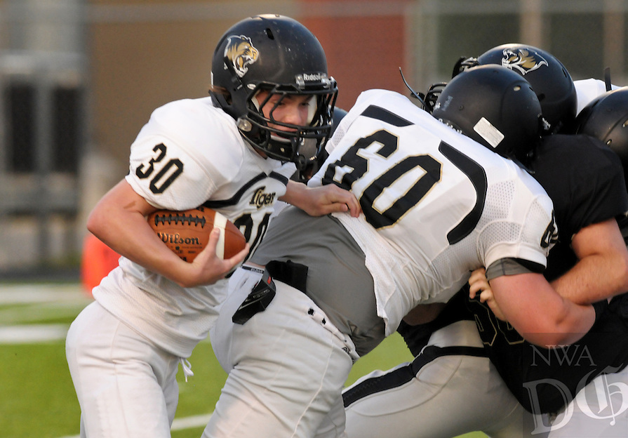 NWA Democrat-Gazette/BEN GOFF @NWABENGOFF<br /> The Bentonville varsity offense and defense scrimmage on Saturday Aug. 22, 2015 at Tiger Pride night in Bentonville's Tiger Stadium.
