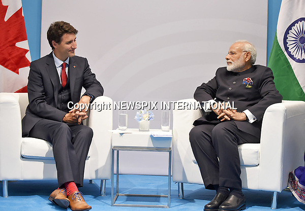 07.07.2017; Hamburg, Germany: JUSTIN TRUDEAU AND NARENDRA MODI <br /> meet at the G20 Summit in Hamburg Germany.<br /> Mandatory Credit Photo: &copy;NEWSPIX INTERNATIONAL<br /> <br /> IMMEDIATE CONFIRMATION OF USAGE REQUIRED:<br /> Newspix International, 31 Chinnery Hill, Bishop's Stortford, ENGLAND CM23 3PS<br /> Tel:+441279 324672  ; Fax: +441279656877<br /> Mobile:  07775681153<br /> e-mail: info@newspixinternational.co.uk<br /> **All Fees Payable To Newspix International**