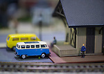 Hicksville, New York, USA. February 22, 2015. Small model minivan and minibus are parked at a train station, at Model Train Exhibit hosted by Trainville Hobby Depot at the Broadway Mall. Donations were accepted at exhibit to support the Nassau County Empire State Games for the Physically Challenged.