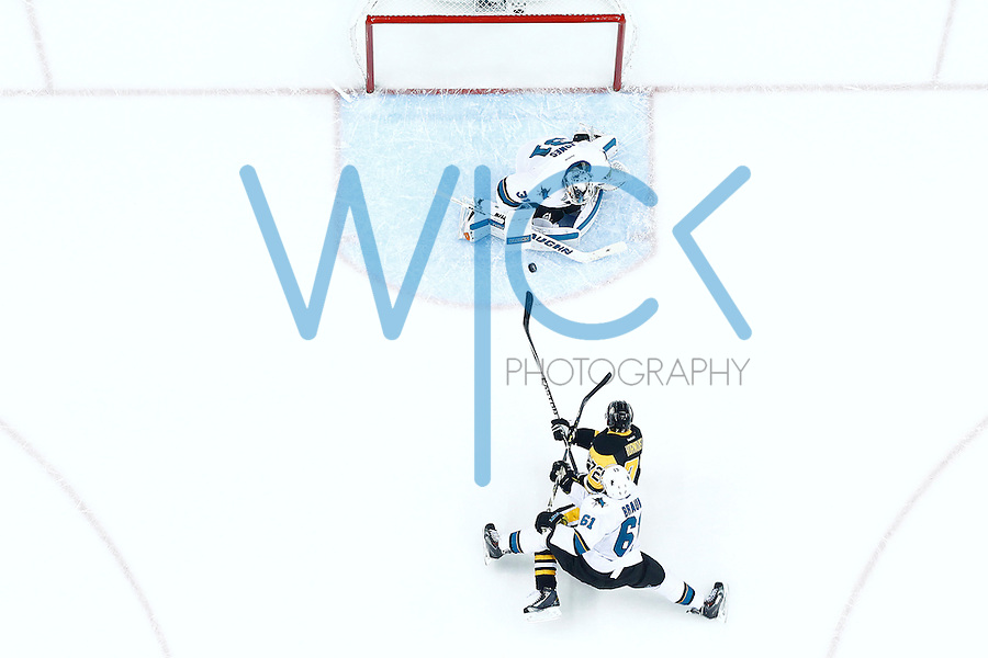 Martin Jones #31 of the San Jose Sharks makes a save on Patric Hornqvist #72 of the Pittsburgh Penguins in the second period during game five of the Stanley Cup Final at Consol Energy Center in Pittsburgh, Pennsylvania on June 9, 2016. (Photo by Jared Wickerham / DKPS)