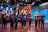First Lady Michelle Obama and Dr. Mehmet Oz learn a dance routine with members of the Terence C. Reilly School No. 7 dance group during a taping of the ?Dr. Oz Show? at the 30 Rock Studios in New York, New York, February 22, 2013. .Mandatory Credit: Chuck Kennedy - White House via CNP