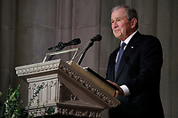 Former President George W. Bush pauses as speaks at the State Funeral for his father, former President George H.W. Bush, at the National Cathedral, Wednesday, Dec. 5, 2018, in Washington.<br /> CAP/MPI/RS<br /> &copy;RS/MPI/Capital Pictures