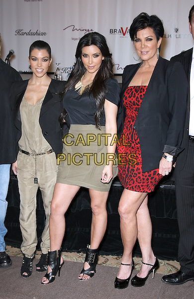 KOURTNEY KARDASHIAN, KIM KARDASHIAN & KRIS JENNER .Press conference held to announce Kardashian Khaos retail store at the Mirage Resort Hotel and Casino, Las Vegas, Nevada, USA..June 28th, 2010.full length black top jacket sisters mother mom mum daughters family red leopard print dress skirt open toe ankle boots sandals beige playsuit jumpsuit .CAP/ADM/MJT.© MJT/AdMedia/Capital Pictures.