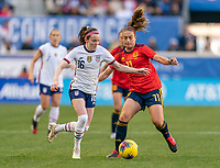 HARRISON, NJ - MARCH 08: Rose Lavelle #16 of the United States dribbles past Alexia Putellas #11 of Spain during a game between Spain and USWNT at Red Bull Arena on March 08, 2020 in Harrison, New Jersey.