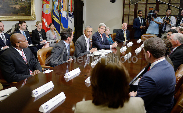 United States President Barack Obama meets with a small group of veterans and Gold Star Mothers to discuss the Iran Nuclear deal in the Roosevelt Room of the White House in Washington, DC, September 10, 2015. Photo Credit: Olivier Douliery/CNP/AdMedia