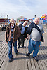 Group of friends with disabilities walking along the pier whilst on a day trip to Skegness organised by Nottingham Disabled Friendship Club,