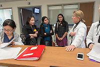 From left, Amber Thai '15, Pari Vanjara '14 and Cecilia Miranda '15 talk with Dr. Kimberly Shriner '80 at Huntington Memorial Hospital, Pasadena, Jan. 8, 2013.<br />