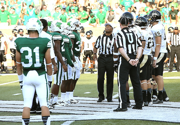 DENTON, TX - AUGUST 31: The coin toss - Texas Mean Green Football vs Idaho Vandals at Apogee Stadium in Denton on August 31, 2013 in Denton, Texas. Photo by Rick Yeatts