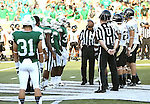 DENTON, TX - AUGUST 31: The coin toss - Texas Mean Green Football vs Idaho Vandals at Apogee Stadium in Denton on August 31, 2013 in Denton, Texas. Photo by Rick Yeatts