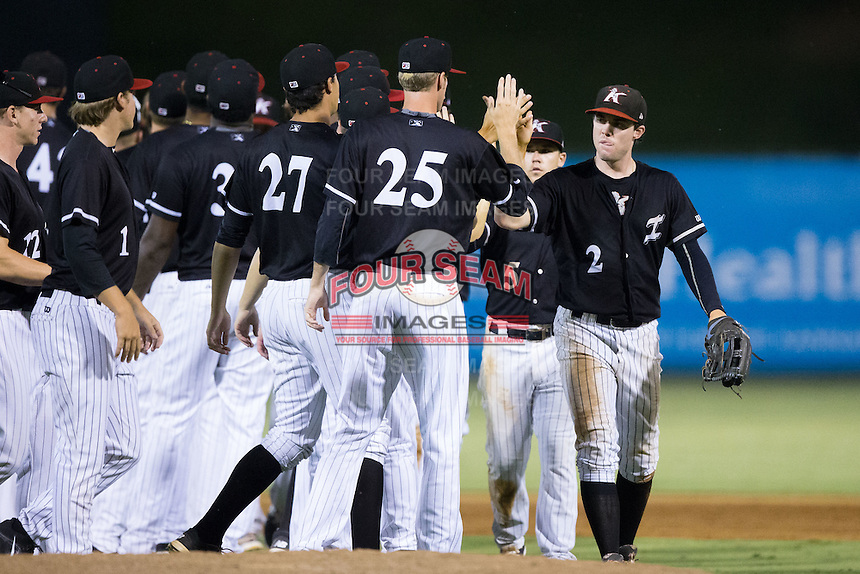 Landon Lassiter (2) of the Kannapolis Intimidators high fives his teammates after their win over the Lexington Legends at Kannapolis Intimidators Stadium on July 14, 2016 in Kannapolis, North Carolina.  The Kannapolis Intimidators defeated the Lexington Legends 4-2.  (Brian Westerholt/Four Seam Images)