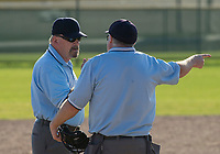 NWA Democrat-Gazette/BEN GOFF @NWABENGOFF<br /> Umpires Tim Bowling (left) and Ray Burwell confer on a call Thursday, April 12, 2018, during the game between Rogers and Springdale Har-Ber at Veterans Park in Rogers.