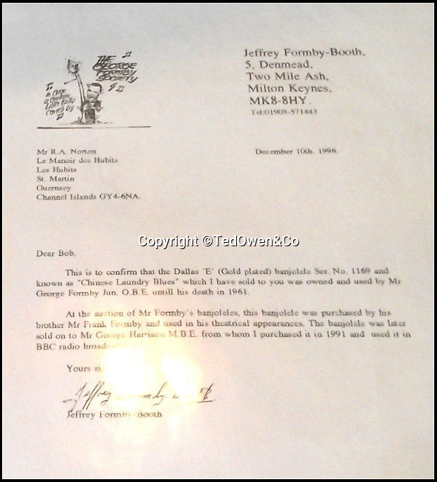 BNPS.co.uk (01202 558833)Pic: TedOwen&Co/BNPS<br /> <br /> A letter from the nephew of Formby confirming that the Dallas 'E' (gold plated) banjolele was owned by George Formby until his detah in 1961.<br /> <br /> A banjo which was owned by both George Harrison and George Formby has emerged for sale for £80,000.<br /> <br /> The legendary Beatle acquired the banjolele in the late 1960s which had been specially hand-made for the famous entertainer George Formby in the 1930s.<br /> <br /> Formby was one of Britain's most popular performers in the 1930s and 1940s and his trademark was to sing comical songs while playing the banjolele.