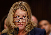Professor Christine Blasey Ford, who has accused U.S. Supreme Court nominee Brett Kavanaugh of a sexual assault in 1982, listens while testifying before a Senate Judiciary Committee confirmation hearing for Kavanaugh on Capitol Hill in Washington, U.S., September 27, 2018. REUTERS/Jim Bourg