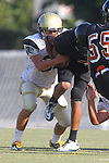 Beverly Hills, CA 09/23/11 - Rory Hubbard (Peninsula #33) and unknown Beverly Hills player(s) in action during the Peninsula-Beverly Hills frosh football game at Beverly Hills High School.