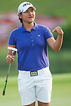 TAOYUAN, TAIWAN - OCTOBER 26:  Yani Tseng of Taiwan reacts to the crowd on the 18th hole during the day two of the Sunrise LPGA Taiwan Championship at the Sunrise Golf Course on October 26, 2012 in Taoyuan, Taiwan. Photo by Victor Fraile / The Power of Sport Images
