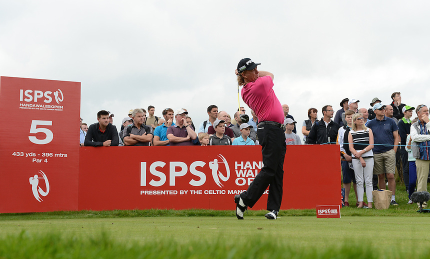 Spain's Miguel Angel Jimenez tees off the fifth tee<br /> <br /> Photo by Ian Cook/CameraSport<br /> <br /> Golf - Day 1 - ISPS Handa Wales Open 2013 - Twenty Ten Course- Thursday 29th August 2013 - Celtic Manor Resort  - Newport<br /> <br /> &copy; CameraSport - 43 Linden Ave. Countesthorpe. Leicester. England. LE8 5PG - Tel: +44 (0) 116 277 4147 - admin@camerasport.com - www.camerasport.com