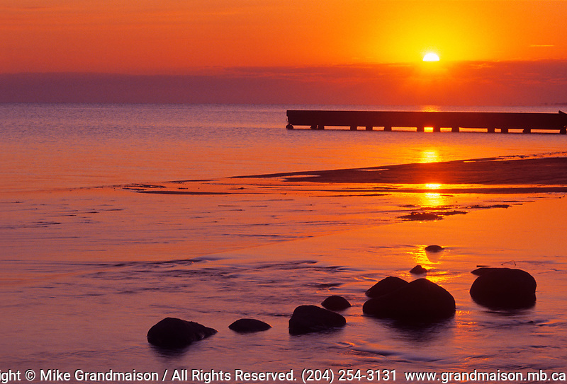 Dock on Lake Manitoba at sunrise<br />