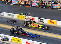 Sep 18, 2016; Concord, NC, USA; NHRA top fuel driver Pat Dakin (near) races alongside J.R. Todd during the Carolina Nationals at zMax Dragway. Mandatory Credit: Mark J. Rebilas-USA TODAY Sports