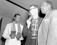 Chuck Berry, an unidentified CHED Radio announcer, and an unidentified performer at the Edmonton Gardens, Alberta,