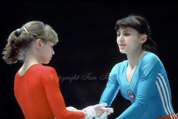 (L-R) Irina Baraksanova and Natalia Yurchenko of Soviet Union prepare to perform on uneven bars during warmups at 1985 European Championships in women's artistic gymnastics at Helsinki, Finland in late April, 1985.  Photo by Tom Theobald.