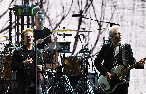Musicians (l-r), Larry Mullen junior, Paul David Hewson (Bono) and Adam Clayton of the Irish band U2 on stage at the Olympic Stadium in Berlin, Germany, 12 July 2017. Photo: Britta Pedersen/dpa-Zentralbild/ZB /MediaPunch ***FOR USA ONLY***