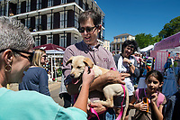 Cotton District Arts Festival - Super Bulldog Weekend.  Dean of the Bagley College of Engineering, Jason Keith with new family puppy.<br />  (photo by Megan Bean / &copy; Mississippi State University)