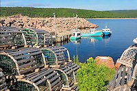 Boats and lobster traps in coastal village<br /> Neils Harbour<br /> Nova Scotia<br /> Canada