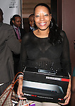 Tammi Butler holds winning raffle prize Sling Box at Beauty and the Beat Vol 2: Heroines for Haiti Hosted by Actress Bobbi Baker-James With DJ Jon Quick Select, The Hip Hop Loves Foundation and Love No Limit Honoring Model Maya Haile, Doris Haircare CEO Marlene Duperley, JRT Multimedia LLC Founder Jocelyn Taylor, Lamb to a Lion Productions CEO Setor Attipoe, Wagner Wolf Publishing CEO and Author Shermian P. Daniel, MD, Cute Beltz Clothing Company Owner Kristen Stevens, Johnny Vincent Swimwear Owner and Chief Designer Celeste Johnny and Visual Artist and Hip Hop Loves Boxing Programs in NYC and LA Founder Vanessa Chakour - Music by DJ Vidal, DJ CEO and DJ Jon Quick Held at Cielo, New York 3/25/2011