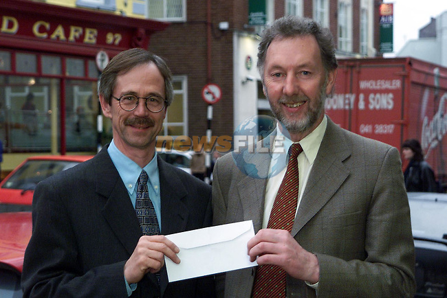 Joe Delaney and Maurice O'Connor .ARCH Club cheque presentation.Pic Newsfil..Camera:   DCS620C.Serial #: K620C-01943.Width:    1728.Height:   1152.Date:  9/3/00.Time:   17:20:08.DCS6XX Image.FW Ver:   3.0.9.TIFF Image.Look:   Product.Antialiasing Filter:  Removed.Tagged.Counter:    [8444].Shutter:  1/80.Aperture:  f4.8.ISO Speed:  800.Max Aperture:  f4.8.Min Aperture:  f30.Focal Length:  56.Exposure Mode:  Aperture priority AE (A).Meter Mode:  Color Matrix.Drive Mode:  Continuous High (CH).Focus Mode:  Single (AF-S).Focus Point:  Center.Flash Mode:  Normal Sync.Compensation:  +0.0.Flash Compensation:  +0.0.Self Timer Time:  10s.White balance: Preset (Flash).Time: 17:20:08.097.