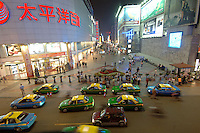 "The new city center of Chengdu is crowded with shops, ads and consumers. Chengdu is the capital of China's most populous province, land-locked Sichuan. The capital city is seeing massive investment of capital as it has modelled itself as the gateway to the western China which the Chinese government are trying to encourage invetement with its ""Go West"" campaign.."