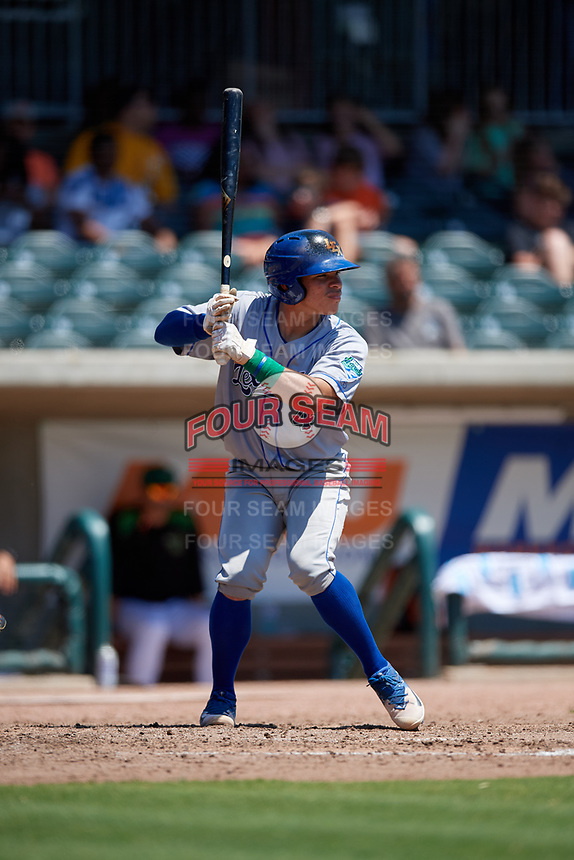Lexington Legends Freddy Fermin (4) at bat during a South Atlantic League game against the Augusta GreenJackets on April 30, 2019 at SRP Park in Augusta, Georgia.  Augusta defeated Lexington 5-1.  (Mike Janes/Four Seam Images)