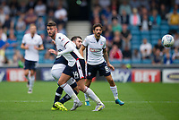 Bolton Wanderers' Gary Madine battles for possession with Millwall's Conor McLaughlin<br /> <br /> Photographer Ashley Western/CameraSport<br /> <br /> The EFL Sky Bet Championship - Millwall v Bolton Wanderers - Saturday August 12th 2017 - The Den - London<br /> <br /> World Copyright &copy; 2017 CameraSport. All rights reserved. 43 Linden Ave. Countesthorpe. Leicester. England. LE8 5PG - Tel: +44 (0) 116 277 4147 - admin@camerasport.com - www.camerasport.com